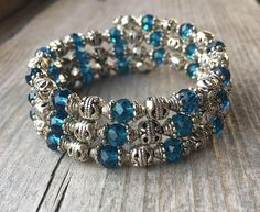 This 3 coil bracelet is made with stainless steel memory wire - will adjust to the size of your wrist and no chance of breaking. This will ensure you will have this bracelet for a long time. Materials include 6mm faceted blue glass beads and assorted Tibetan silver spacer beads. #beadedjewelry
