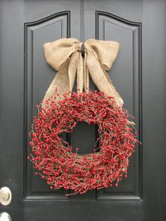 @T Tuakoi LOVE the BIG burlap bow! (and of course the red berries too!) Here is another Burlap DIY!
