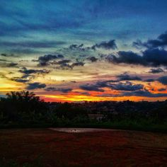 Sunset over the field... #sunset #goodbye #tomorrow #fire #flames #gradient #gradientnation #vanishing #mixture #bluesky #cloudporn #nikon_photography #lgphone #photographylovers #photography #photoshoot #field #red #homemade #view #hills #yaoundébynight #yaoundé #promenade #vue #visiterlafrique