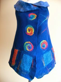 .beautiful blue felted vest with colorful cieprcles and squares