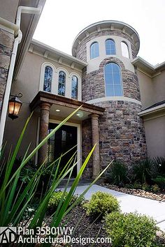 Tuscan House Plan 35801WY - stairs are in the rounded feature  4,400+ sq. ft. 4 beds shown built for a client in Texas