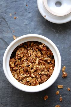 molasses granola recipe. rolled oats with quinoa and flaxseed meal, chocking it up with crushed walnuts and flax seeds, and dressing it in olive oil, maple syrup, and a game-changing ingredient: molasses.
