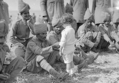 Historical Times : PhotoA French boy introduces himself to Indian soldiers who had just arrived in France to fight alongside French and British forces, Marseilles, 30th September 1914 -
