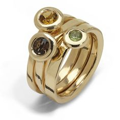 Chunky gold ring with semi-precious stones. Think this would make a funky Mothers ring!! Hint!!!