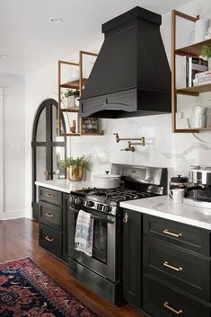 Bold Design - Black Cabinets - Modern Farmhouse Small Kitchen Design which contains modern furniture such as buffet, which is placed on the ground and has many outstanding Shutters and buffet. Black Kitchen Cabinets, Kitchen Cabinetry, Black Kitchens, Home Kitchens, Small Kitchens, Kitchen Fixtures, Kitchen Backsplash, Kitchen Appliances, Dream Kitchens