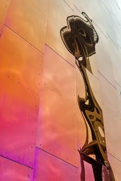 reflection of space needle in wall of experience music project