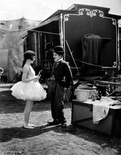 Charlie Chaplin and Merna Kennedy at the circus in 1928.