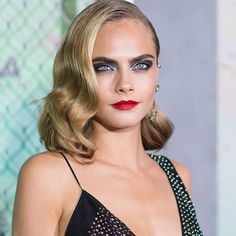 "Trending Makeup: ""Shiny Glitters"" Cara Delevingne in smokey eyes with silver glitter."