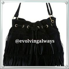 Black Crossbody Fringe Handbag Nice size handbag does fit crossbody. Has a snap closure or you can use the drawstring to close. Suede like material and very light weight. Fringe in the front of the bag. (New) Bags Crossbody Bags