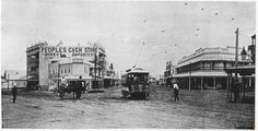 Fiveways at Woolloongabba, A horse and cart waits for a tram to go by at the intersection. A road worker is also attending to maintenance near the tram. The People's Cash Store building is visible at the centre of the intersection. Brisbane Gold Coast, Brisbane City, North Beach, Sunshine Coast, Train Travel, Historical Photos, Vintage Images, Old Photos, Street View