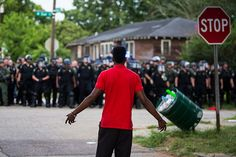 FBI Greenlights Crackdown on Black Lives Matter Protesters -- Black Lives Matter protesters face off with law enforcement officers in Baton Rouge, La., July 10, 2016. (Photo: Edmund D. Fountain / The New York Times)