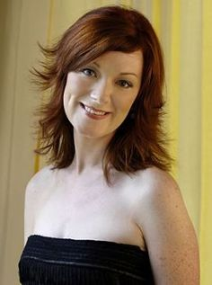**Orla Fallon of Celtic Woman. Orla leaving in 2009 and Alex Sharpe would replace Orla.  One of the original Celtic Woman. Husband is John and a son Freddie.