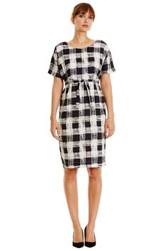 Navy woven shift dress with check print in 100% organic certified cotton. Matching tie waist with kimono sleeves and invisible back zip. Length 101cm.
