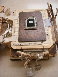 Altered book by Castro Ferreira Alexandra that was mad in a Nina Bagley class at Art Fest