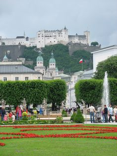 Salzburg, Austria. The Mirabell Gardens in the foreground, the beautiful domes above, and the old fortress overseeing it all.
