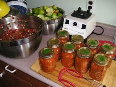 Salsa canning  12 to 14 500ml jars  8 to 12 hours - 2 1/2 to 3 hours working    8 quarts plum tomatoes  pickling salt  6 large onions (red are good if you can get them)  2 to 3 heads of garlic  450 grams (1 pound) Jalapeño chiles  6 large mild green chiles (peppers)  2 1/2 cups minced cilantro  1/4 cup cumin seed, ground  1 156ml (5 1/2 ounce) can tomato paste  PER JAR 3 tablespoons lime juice