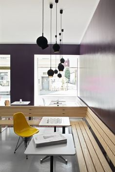 Aubergine wall, benches and hanging lights