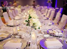 Stunning reception tables at the Alexander Hotel. Floral Design by McNamara Florist. All Rights Reserved.