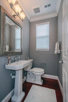 Traditional Powder Room With Built In Bookshelf White