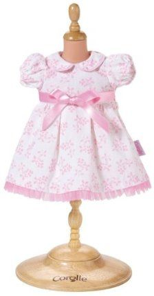 """Corolle Classic 14"""" Doll Fashions (Pretty Dress) by Corolle. $20.68. Every Corolle doll is styled in France. A collection of styles for all occasions. At Corolle we bring caring, savoir-faire and style to everything we create, so that every little girl can find the doll of her dreams in our collection. These styles were inspire by those for real babies and range from classic to contemporary. The delicate pink and white print of this pretty dress is perfect for the C..."""