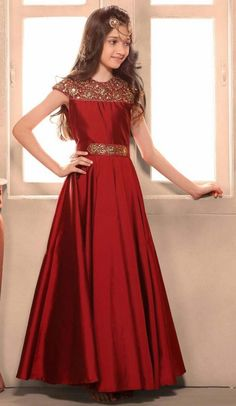Maroon Color Taffeta Silk Fabric Readymade Kids Girl Gowns. you are able to see some intriguing patterns completed with embroidery work for kids girl party wear gowns dresses.