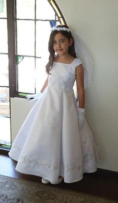 So sleek and modern - this bridal satin communion or flowergirl dress has embroidered appliques on the bodice and trimming the bottom of the skirt. http://www.weddingaccents.com/accessories/ag-dr1586-floorlength-communiondress.htm