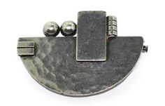 JEAN DEPRES. A silver brooch of industrial geometric geometric design