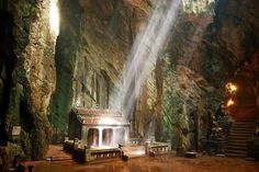 Check out the caves in the Marble Mountains. It's a day trip from the beach town of Da Nang, Vietnam.