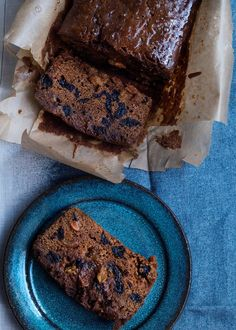 malt loaf in parchment paper and a slice of it on a round plate