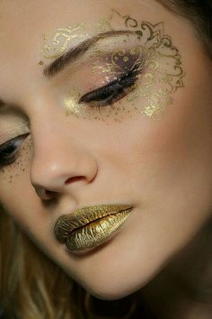 Face gold tatoo