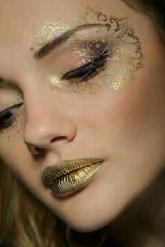 Face gold tatoo
