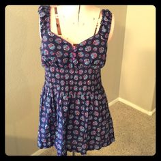 Free People top/tunic Free People top/tunic EUC colors are dark blue, light blue, light green, pink and red with purple buttons and purple around neckline. Can be worn as a short dress too. Free People Tops Tunics