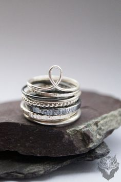 Tower Of Sterling Silver Rings A beautiful selection of eight sterling silver rings! This collection includes three 2mm bands and five skinny 1mm