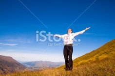 Freedom businessman on top of a mountain Royalty Free Stock Photo