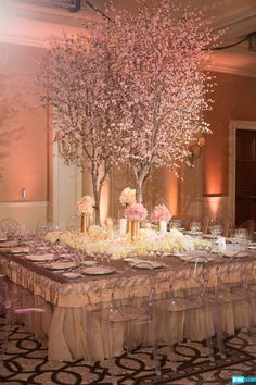 Cherry blossom trees elegantly accent the fairy tale reception tables.