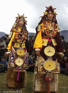 Ceremonial costumes of Yading (or Daocheng in Chinese) worn at a grassland horse festival