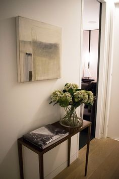 Kenner house hallway with floral display and home accessories - Kenure House project by Echlin London design studio. Luxury home located close to Holland Park, London including many  contemporary and British designs. Featuring on the Martyn White Designs Blog www.martynwhitedesigns.com
