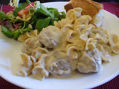 Meatball Stroganoff in a crockpot.  (I didn't make this in the crockpot.  Used pre-cooked frozen meatballs, added an extra can of cream of mushroom soup, a pkt of Lipton Onion Soup mix and some cajun spices.  The kids were licking the pot clean!  Definite keeper.  ~A)