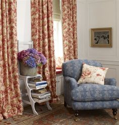 Curtains - LF1683C/5 - Lotus. Cushion - LF1682C/3 - Carnation. Chair - LF1684C/4 - Cornflower. The blossom curtains add such warmth to this sitting room.