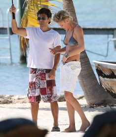 Charlize Theron in Bikini at a Photoshoot on the Beach in Miami, March 2014.