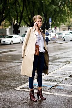 A long french trench, white shirt tucked in, tight dark jeans and boots.