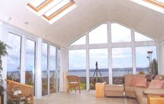 Sunroom with skylights & Nice view of a lake in back ~