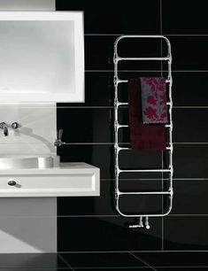 Zehnder Nobis and its high quality chrome finished tubes bring a special look to every bathroom. The large spacing between the tubes combines distinctive character with functionality. Several towels can be heated at the same time. Bath Towel Racks, Bathroom Towel Rails, Bathroom Storage, Mirror Radiator, Towel Radiator, Bookcase Wall, Bookcase Storage, Bookshelf Design, Wall Shelves