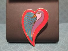 Check out this item in my Etsy shop https://www.etsy.com/listing/213631127/laurel-burch-dove-heart-22k-gold-plate