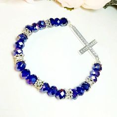 Only $8.29!! - Silver Rhinestone Cross Stretch Bracelet, Sapphire Faceted Glass Rondelle Beaded Stretch Bracelet, Cobalt Blue Beaded Silver Gemstone Cross Bracelet, Christian Jewelry, Inspirational Cross Bracelet, Huge Etsy Shop Sale, Gifts For Her Under $10 - FREE USA SHIPPING https://www.etsy.com/listing/593116609/silver-rhinestone-cross-stretch