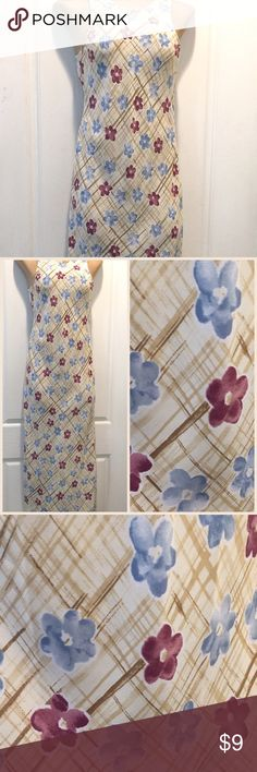 "JCPenny My Michelle Floral Maxi Dress 7/8 JCPenny My Michelle Floral Maxi Dress 7/8. Dry Clean only 100% Polyester Tag reads 7/8. Approx Measurements laying flat - shoulder width 1.75"" - across chest pit to pit 20"" - length back of collar to hem 52"" EXCELLENT USED CONDITION My Michelle Dresses Maxi"