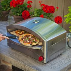 Add a taste of Italy to your outdoor cooking with this Camp Chef Italia Artisan portable pizza oven. This portable pizza oven is designed to replicate the performance of a wood-fired brick oven while providing the heat control and responsiveness to cook t Best Outdoor Pizza Oven, Home Pizza Oven, Gas Pizza Oven, Portable Pizza Oven, Pizza Ovens, Electric Pizza Oven, Gas Oven, Microwave Oven, Camp Chef