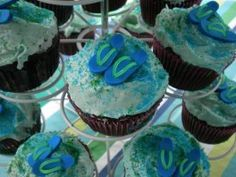 Serve fun cupcakes at your Flip Flop party. Tiny flip flop erasers top cupcakes that have blue and green sugar sprinkled on the top. Display them in a cupcake tower to use as a centerpiece.