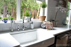 Organizing Idea - use a basket next to the sink to store kitchen hand towels.  That way, drawer space is not needed