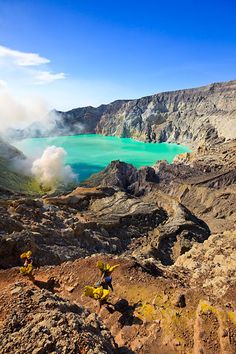 Ijen volcano, known locally as Kawah Ijen, with its 1km wide turquoise-coloured acid crater lake in the centre, home to a labour intensive sulphur mining operation.